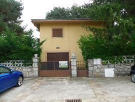 Casa con garaje y Jardín photo 0