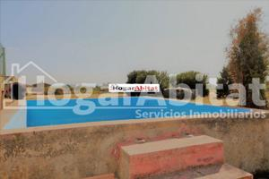 Chalet con piscina, paellero y gran parcela photo 0