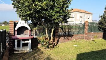 Planta baja con jardín  y  ampliar terraza al sur de dos habitaciones ,garaje y trastero en Suances photo 0