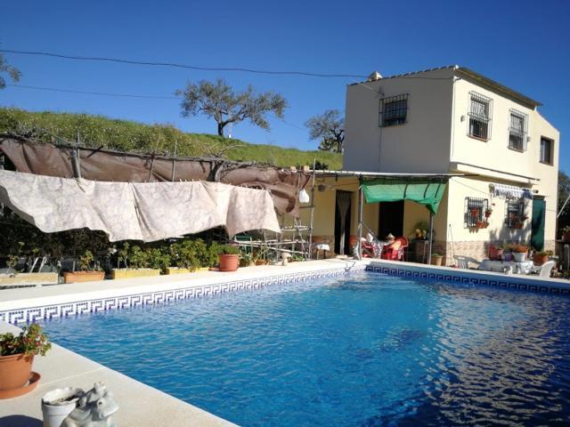 Casa De Campo En venta en Coín photo 0