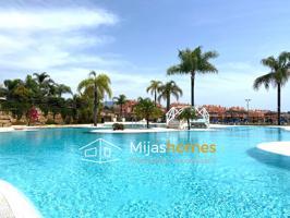 Estupendo apartamento de 3 dormitorios y 2 baños está situado en la zona residencial El Chaparral en Mijas Costa cerca de un Club de Golf, en un enclave único de diseño contemporáneo rodeado de naturaleza y con increíbles a la naturaleza y al mar. photo 0